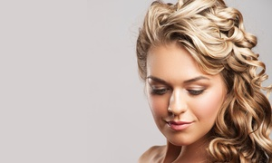 Touch of Faith Hair Salon: Haircut Package with Optional Highlights, Color and Massage at Touch of Faith Hair Salon (Up to 64% Off)