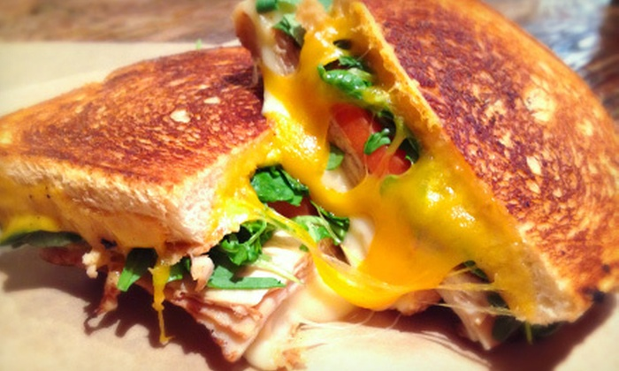 Melt It! - West Central: Grilled Cheese Combo Meals for Two or Four at Melt It! (Up to 57% Off)