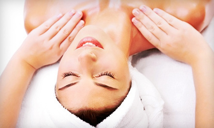 YOLO Nail Salon and Day Spa - Winter Park: $99.99 for a Spa Package with a Facial, a Massage, a Mani-Pedi, and Wine at YOLO Nail Salon and Day Spa ($259 Value)