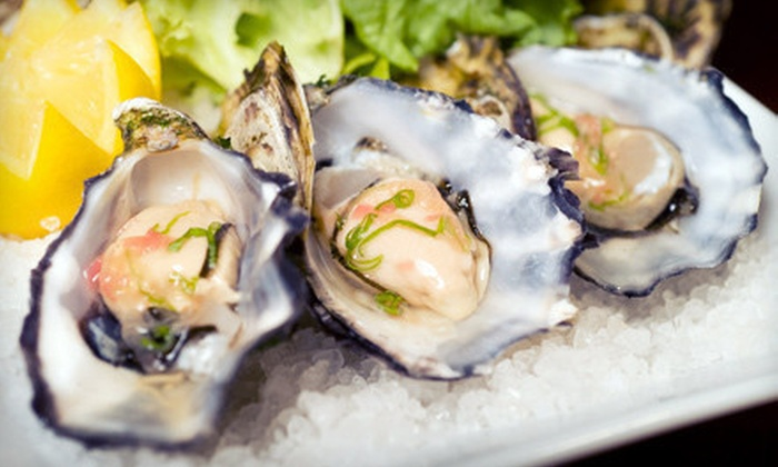 Eats on Lex - Upper East Side: $39 for Two Dozen East Coast Blue Point Oysters and Two Martinis, Beer, or House Champagne at Eats on Lex ($102 Value)