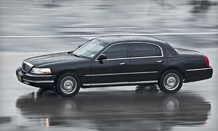 Border Limousine Service - Boston: Roundtrip Airport Transportation in a Sedan or a Van or SUV from Border Limousine Service (Up to 58% Off)
