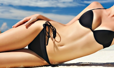 One or Three Months of Unlimited Tanning or Three Spray Tans at Sun Kissed Tanning (Up to 64% Off)