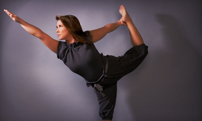 Urban Yoga Spa - Belltown: $38 for 10 Yoga Classes at Urban Yoga Spa ($150 Value)
