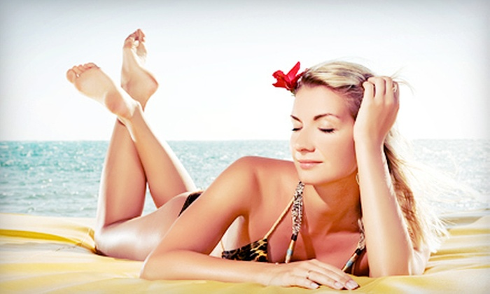 KoKoMo Glow Tanning Boutique - Skipwith Farms: One or Three Spray Tans or One Month of Unlimited UV Tanning at KoKoMo Glow Tanning Boutique (Up to 64% Off)