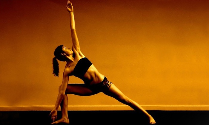 Redmond Bikram Yoga - Downtown Redmond: 20 Days of Unlimited Yoga or a 10-Class Card at Redmond Bikram Yoga (Up to 80% Off)