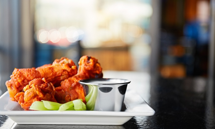 Jus Wingz Bar and Grill - Gulfton: Jus Wingz Bar and Grill (Up to 31% Off). Two Options Available.
