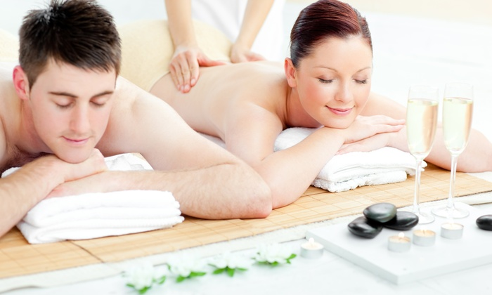 White Raven Spa Company - Louisville: $129 for a Couple's Massage Package with Sea-Salt Back Scrub at White Raven Spa Company ($280 Value)