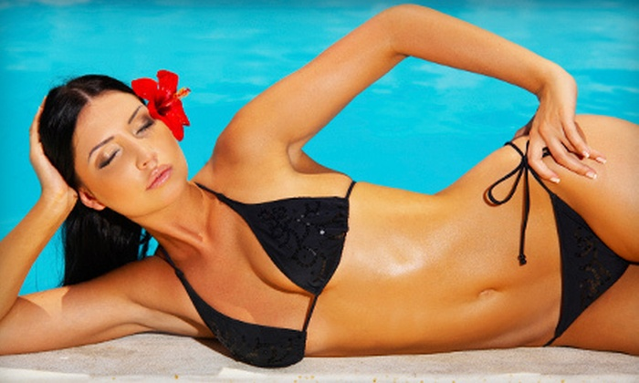 Afterglow Tanning Salon - Paradise Valley: One or Three Airbrush Tans or One Month of Unlimited UV Tanning at Afterglow Tanning Salon (Up to 59% Off)