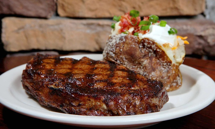 Santa Fe Cattle Company - Penningtom Bend: $11 for $20 Worth of Steaks, Ribs, and Fajitas at Santa Fe Cattle Company