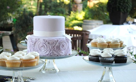 One Wedding or Custom Cake or Two Dozen Standard Cupcakes from Crème de la Cake (40% Off)
