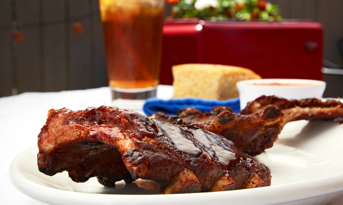The Rib Trader - Orange: $28 for Jim's Barbecue Family Pack for Four at The Rib Trader ($53 Value)