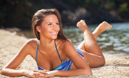 One or Four Airbrush Spray Tanning Sessions at Solé Spa Wellness Center (Up to 53% Off)