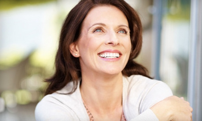 Comfort Dental Spa - Multiple Locations: $1,498 for a Dental-Implant Package with Exam, X-rays, Abutment, and Crown at Comfort Dental Spa (Up to $4,170 Value)