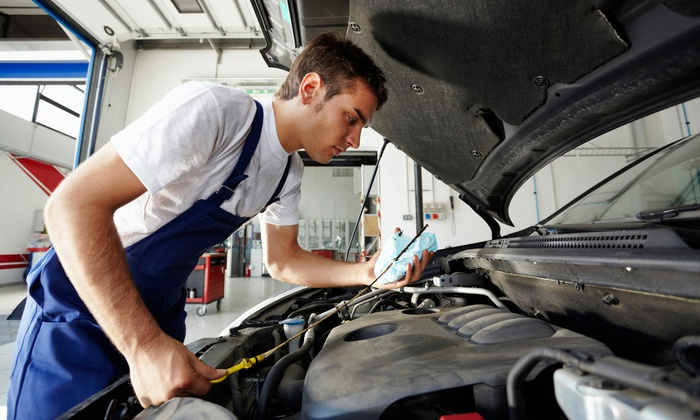 Dallas Car Care - Multiple Locations: Car-Care Package Including Oil Changes and Tire Rotations at Dallas Car Care (87% Off). Three Locations.