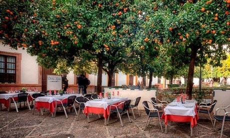 La Hostería de Doña Lina: menú completo para dos o cuatro con botella de vino desde 29,95 € en el barrio de Santa Cruz Oferta en Groupon