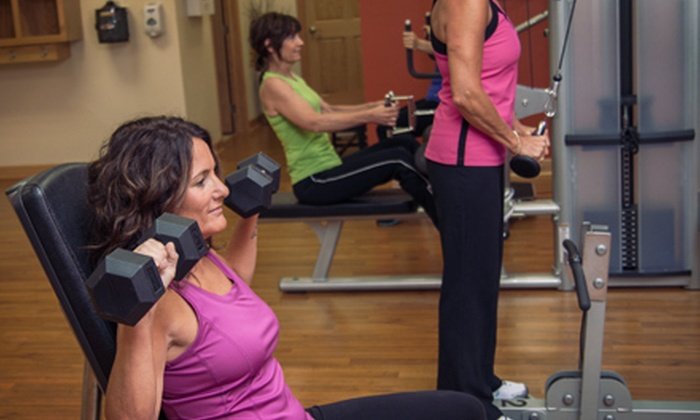 Get In Shape For Women - Multiple Locations: 8 or 13 Group Training Sessions Plus 2 Nutrition Sessions at Get In Shape For Women (66% Off)