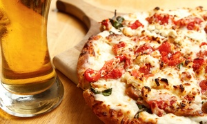 East Side Pizza : Pizza with Beer or Wine for Two or Two Pasta Dishes at East Side Pizza (Up to 56% Off)
