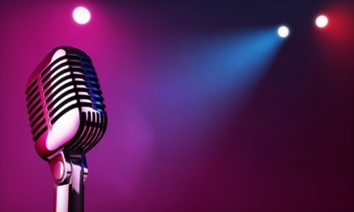The Laughing Skull Lounge - Midtown: $22 for a Comedy Package with Digital Download and Two Tickets at The Laughing Skull Lounge (Up to $57.20 Value)