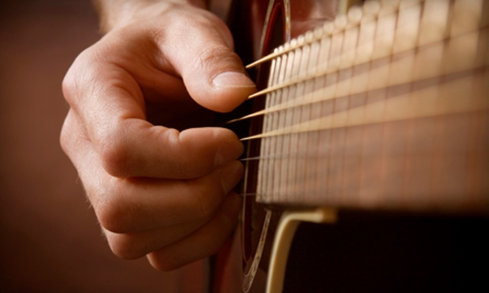 American Guitar Academy - Onondaga: $49 for Four Private Guitar Lessons with Free Lesson e-Book at American Guitar Academy ($129.95 Value)