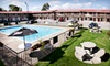 Candlelight Inn & Mick and Angelo's - Niagara Falls: One- or Two-Night Stay with Dining Credit at Candlelight Inn (Up to 58% Off). Purchase Multiple Groupons to Extend Stay.