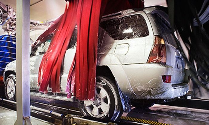 Danny's Family Car Wash - Multiple Locations: $22 for Three Car-Wash Packages with Spray Wax and Vacuum at Danny's Family Car Wash (Up to $44.97 Value)