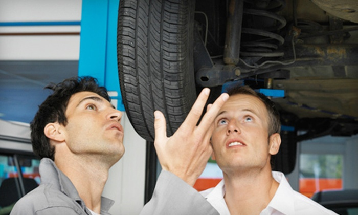Auto-Lab - Saint Clair Shores: Three Oil Changes with Tire Rotations and Inspections, Pothole Package, or Spring AC Package at Auto-Lab (Up to 63% Off)