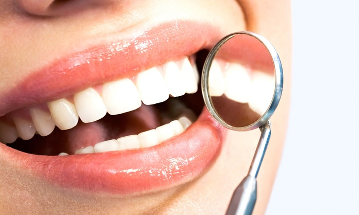 Village Dental - Multiple Locations: $59forOne Dental Exam, Cleaning, and X-Rays (Up to$385value)