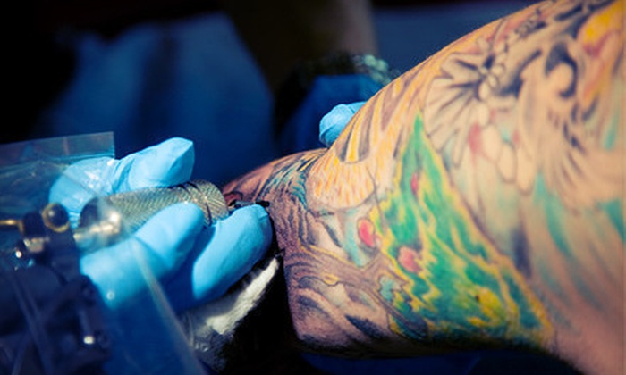 Bulldog Lifestyles - Multiple Locations: Piercings or Tattoos at Bulldog Lifestyles (Up to 55% Off)