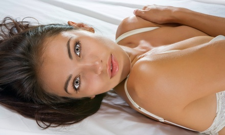 $15 for One VersaSpa or Glissin Spray Tan at Glissin  ($43 Value)