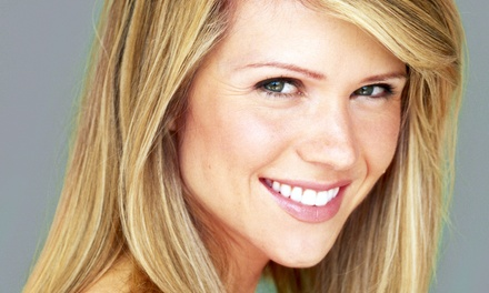 Haircut with Options for Color or Highlights from Cindy Graham at Rhapsody Salon (Up to 73% Off)