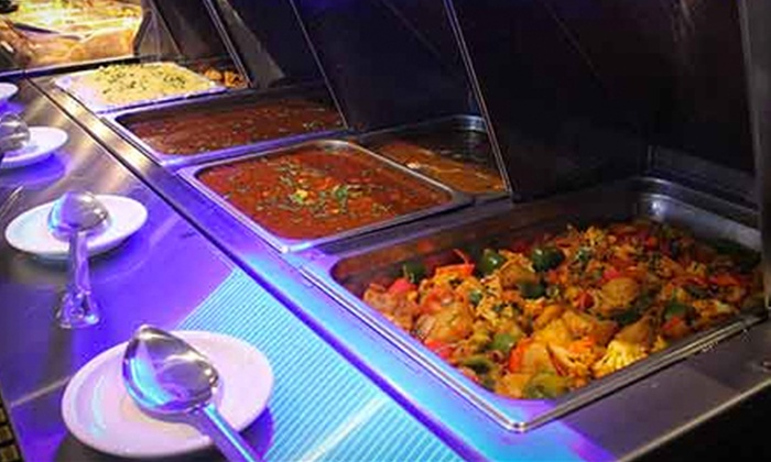 Dhoom Restaurant & Lounge - Downtown Winnipeg: Indian and Canadian Food for Two or Four at Dhoom Restaurant & Lounge (Half Off)