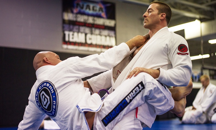 Team Curran MMA Inc. - Team Curran MMA: Kickboxing, Jiu-Jitsu, and Boxing Classes at Team Curran MMA Inc. (Up to 72% Off). Three Options Available.