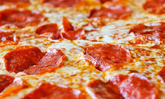 Good Eats Pizza - 1: One Medium Pizza with Caesar Salads, or Two Medium Pizzas with Breadsticks and Soda at Good Eats Pizza (Up to Half Off)