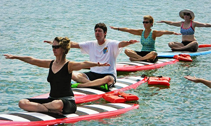 Beach Yoga Pinellas - Multiple Locations: Standup-Paddleboard Yoga Class with Board Rental at Beach Yoga Pinellas ($60 Value)