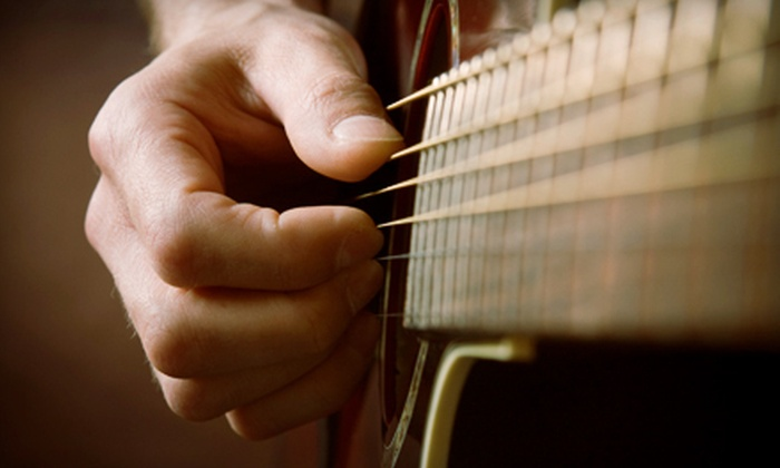 Backstage Guitars - Multiple Locations: One Month of Weekly 30-Minute Guitar or Drum Lessons with Guitar-Rental Option at Backstage Guitars (Up to 55% Off)