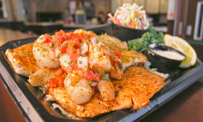 Tin Fish Clematis - Downtown West Palm Beach: Lunch or Dinner for 2 or 4 or $15 for $22 a Toward Bar Tab at Tin Fish Clematis (Up to 39% Off)