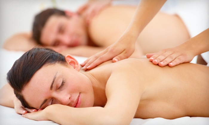 New Paradigm Massage - Cherry Creek: $95 for 60-Minute Couples Massage with Aromatherapy Foot Soak and Wine or Champagne at New Paradigm Massage (Up to $190 Value)