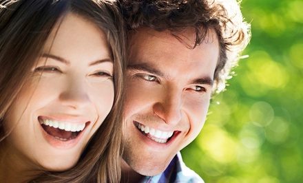 Dental Exam Package or Take-Home Custom Whitening Trays at Ultimate Smile Dental (Up to 82% Off)