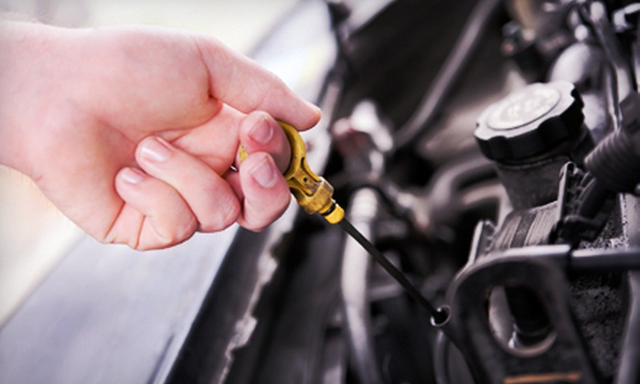 C&J Auto & Truck Service Center - Multiple Locations: One or Three Oil-Change Packages or an AC Service Check at C&J Auto & Truck Service Center (Up to 65% Off)