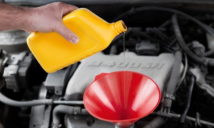 D & B Transmission - Washington: Oil Change with 39-Point Inspection or Alignment, Balancing, and Tire Rotation at D & B Transmission (Up to 57% Off)
