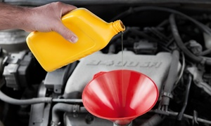 D & B Transmission: Oil Change with 39-Point Inspection or Alignment, Balancing, and Tire Rotation at D & B Transmission (Up to 57% Off)