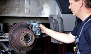 Manchester Tyre Trading LLC: Brake Pad Change Labour with Alignment, Pressure Check, and Fluid Top-Up at Manchester Tyre Trading (Up to 62% Off)