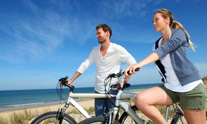 Tri-Pacific: Four-Hour or 24-Hour Bike Rental with Lock and Helmet from Tri-Pacific (Up to 67% Off)