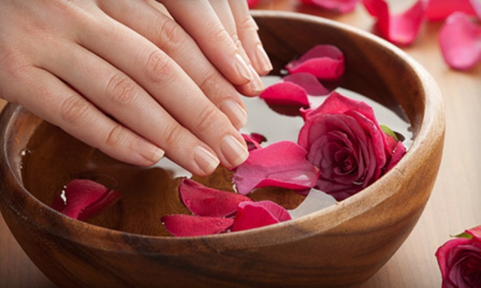 Chateau Beauty Lounge - City Center: Classic Manicure or Full Set of Acrylics with Two Nail Designs at Chateau Beauty Lounge (Up to 57% Off)