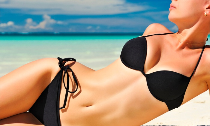 Expressions Tanning - Multiple Locations: One Airbrush Tan or One Month of Ruva Level 2 UV Tanning at Expressions Tanning (Up to 50% Off)
