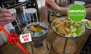 Uptown Freehouse: Fondue + Wine or Beer for Two People: Vegetarian ($29) or Meat ($35) at Uptown Freehouse (Up to $77 Value)