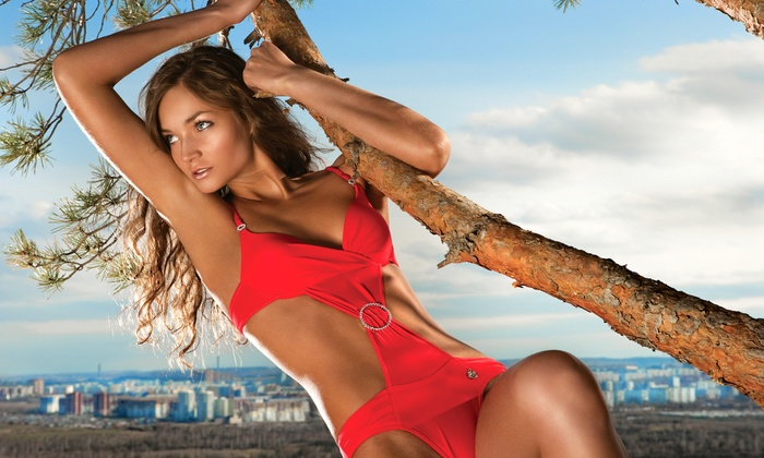 Beauty Bar Laser Clinic - Multiple Locations: C$49 for One Month of Unlimited Bed or Spray Tanning at Beauty Bar Laser Clinic (C$149 Value)