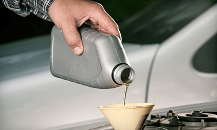 Auto-Lab - Multiple Locations: Oil Change and Tire Rotation at Auto-Lab (Up to 69% Off). Two Locations Available.