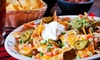 Taqueria El Rodeo LLC - Oak Forest: $11 for a Nacho Meal for Two with Soda, Beer, or Margaritas at Taqueria El Rodeo (Up to $21.97 Value)