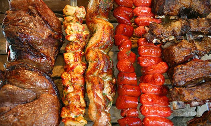 Midwest Grill - Multiple Locations: Brazilian Barbecue Dinner for Two or Four Adults at Midwest Grill (Half Off)